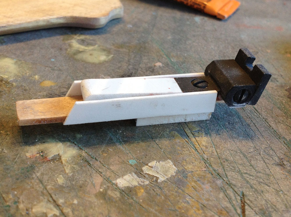 Ebony's rear sight is a two-part adjustable piece that I just scratch build from wood and bits of plastic.
