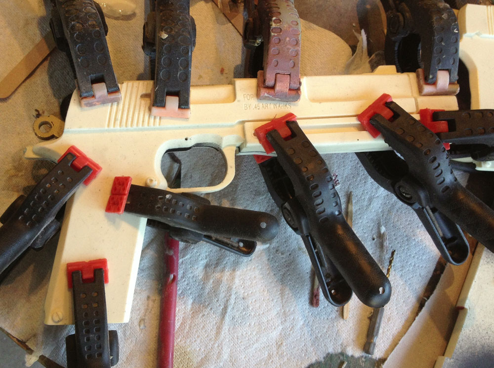 I applied some two-part epoxy and clamped the gun bodies to dry.
