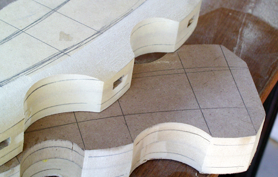 I started to shape the bumps on the belt sander, rounding the outer edges.
