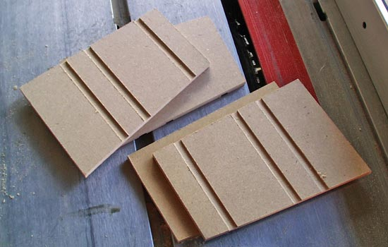 "The magazine sides were made from 1/4"" MDF. I cut decorative slots in the sides with the table saw."