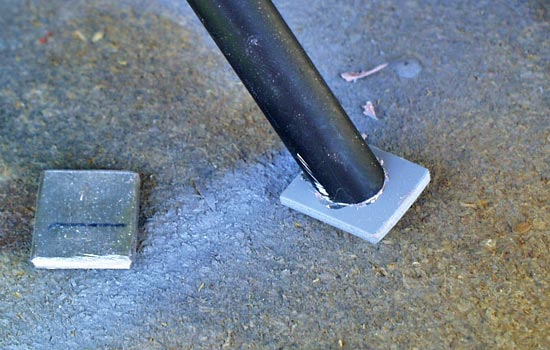 For the feet, I cut a square of steel and epoxied them to the legs.