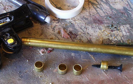 I cut posts from brass tubing that will also hide the knob attaching screw.