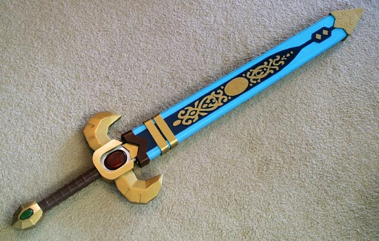 Here is the final scabbard. The blue and gold details were cut out of thin plastic.