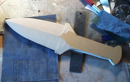 After gluing the blade halves together, I shaped the blade edges on the belt sander.