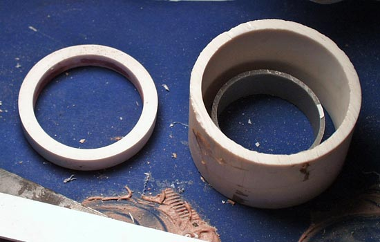 To fabricate the ring around the star at the pommel, I inserted one PVC pipe inside another and cast resin between them.