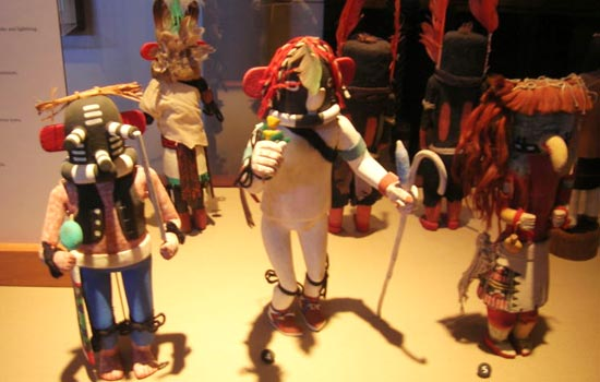 "I saw a bunch of these at a local museum, and thought how much some of them looked like action figures. Perhaps ""a long time ago"" a Hopi fella happened to spot a certain intergalactic bounty hunter apprehending his prey, and decided to carve a Kachina of this obviously supernatural vision."