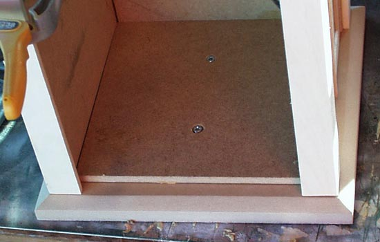 The base was cut out of 1/2″ MDF with a 1/4″ MDF insert to keep the walls square.