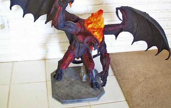 The Balrog now has a new home and SO FAR the hasn't fallen over.