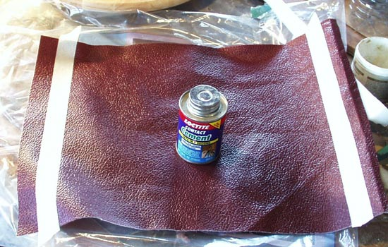 BUT before I could do that, I needed to line the inside to make it more comfortable to wear. I found a cool burgundy leather textured vinyl that would work great. I cut a piece to size, glued the seam with contact cement.