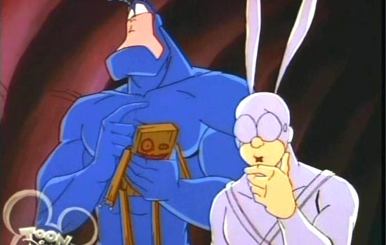 """The Tick, a large, blue, strong but stupid and INSANE superhero, is upset that his sidekick Arthur wants to skip """"Craft Night"""". Sulking in his apartment, the Tick sees """"a little boy trapped in a block of wood"""" and decides to free him."""