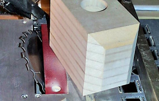 The bevels of the hammer were cut by tilting the table saw blade 45 degrees.