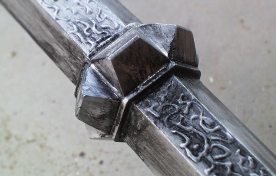 "I added the ""Black Tongue"" runes to alternating facets of the shaft with craft ""puffy paint""."