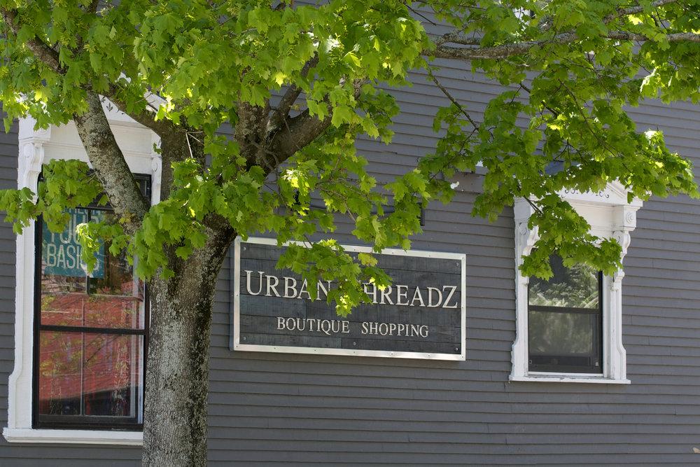 urban threadz exterioe wide shot with tree.jpg