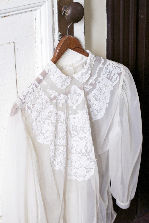 sheer blouse on hanger.jpg