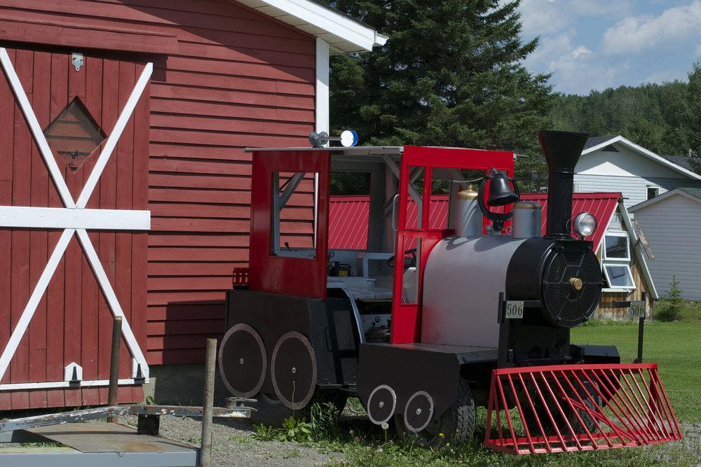 Fancy-engine-by-barn.jpg