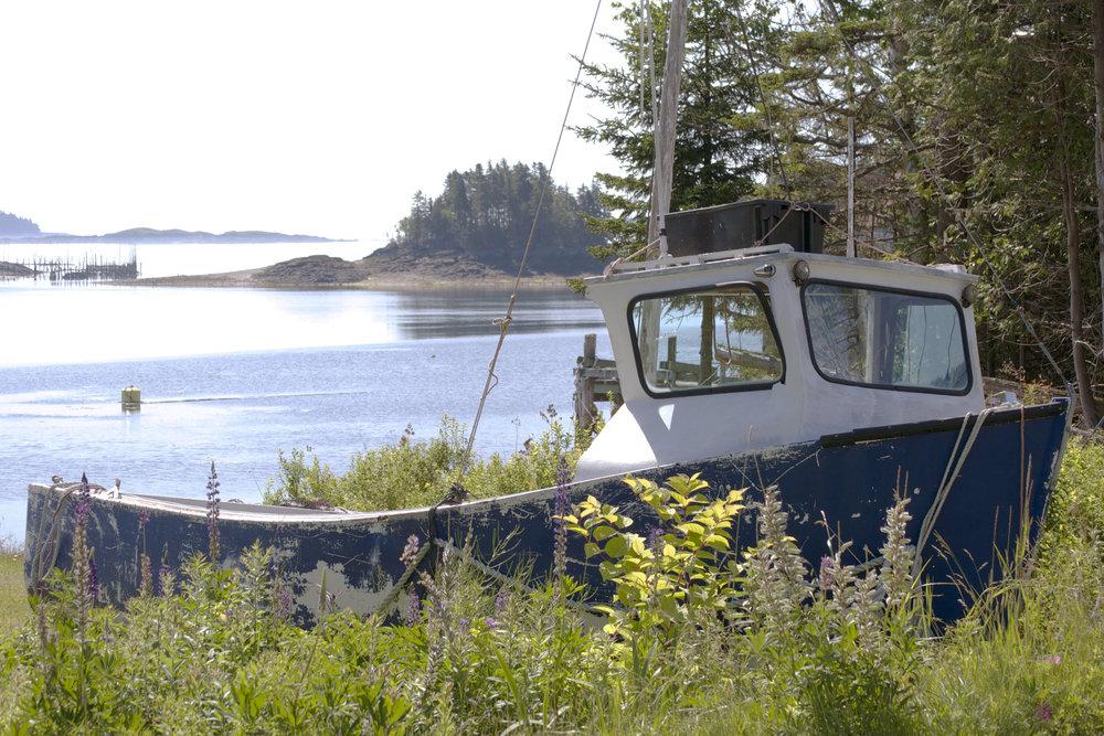 abandoned-boat-broken-window-wide-view.jpg