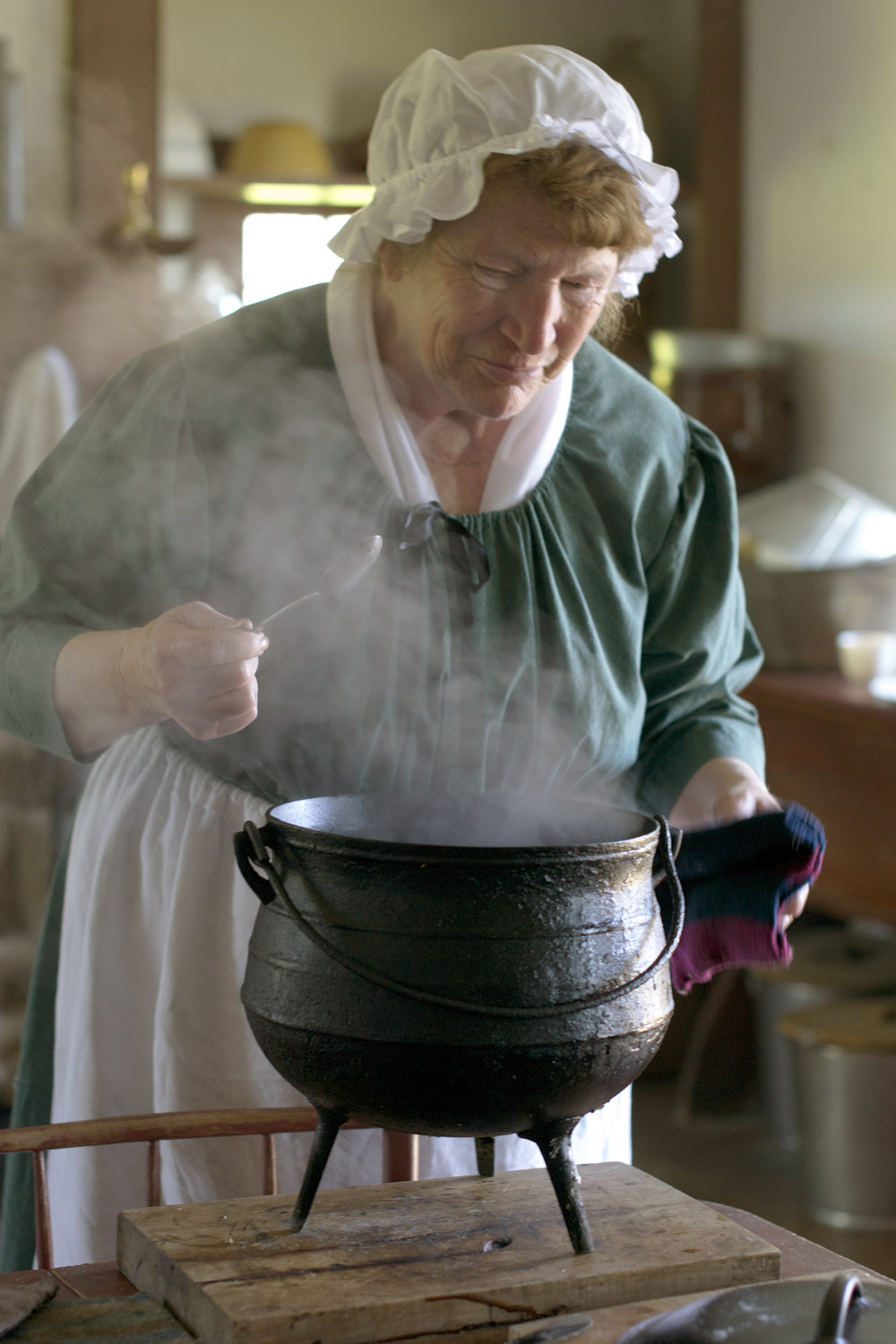woman stirring a steaming pot.jpg