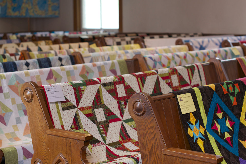 quilts-on-pews.jpg