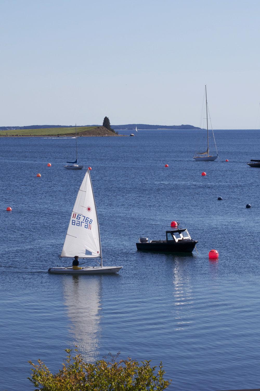 pretty-lazer-sailboat-reflection.jpg