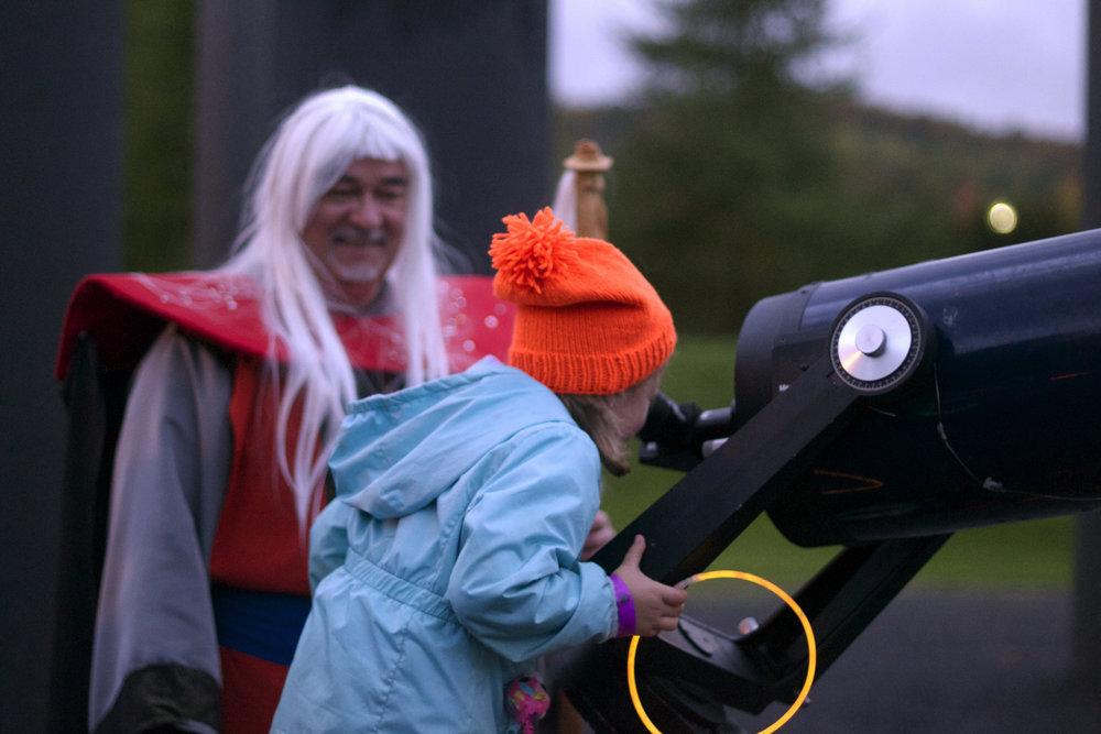 girl-telescope-wizard-smiling.jpg