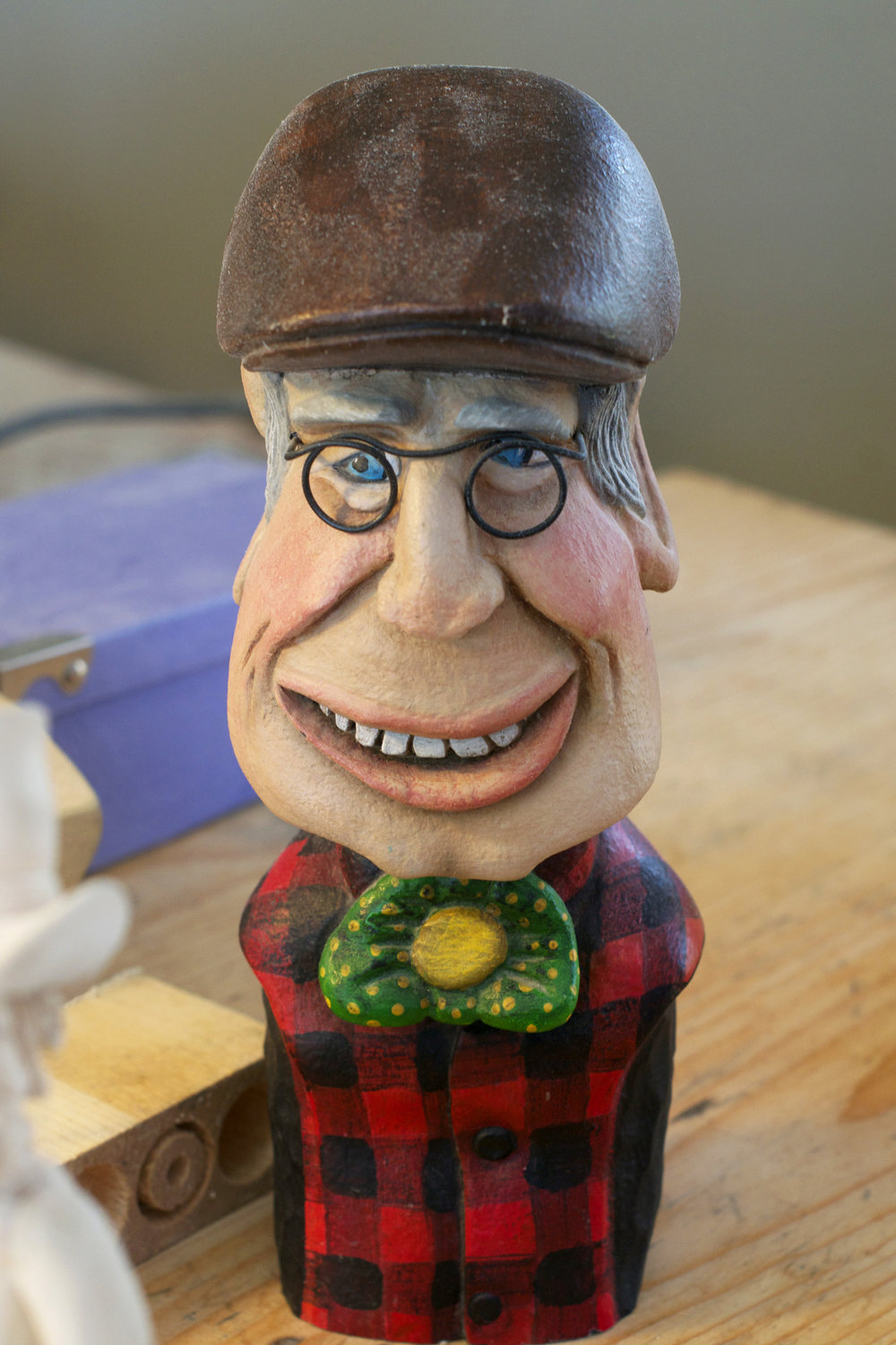 luc's-carving-sculpture-likeness-of-himself.jpg
