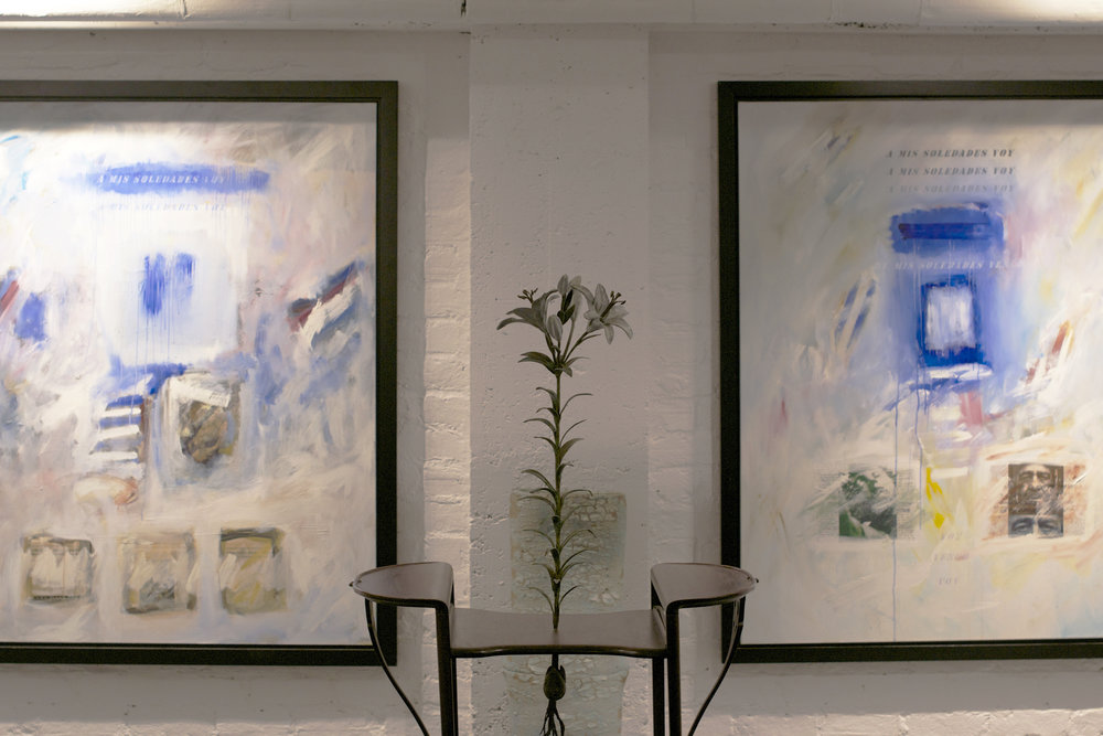 basement-gallery-table-flower-two-paintings.jpg