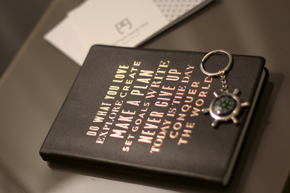 travel-journal-and-keychain-gifts.jpg