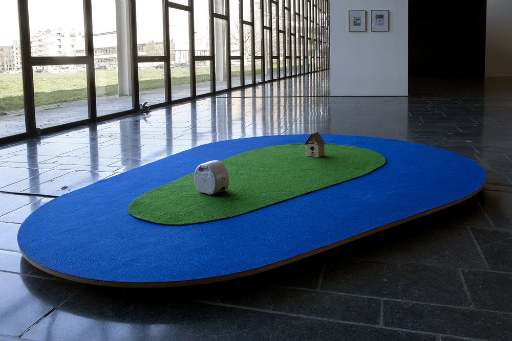 Bark Control: Installation (carpet, mdf, a barkcontrol-device and an electronic dog-device, 2 framed manuals), 2mx4m