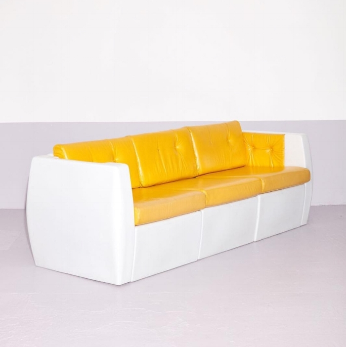 Photo of Wild 70s vinyl sofa from IG @comingsoonny  https://comingsoonnewyork.com/