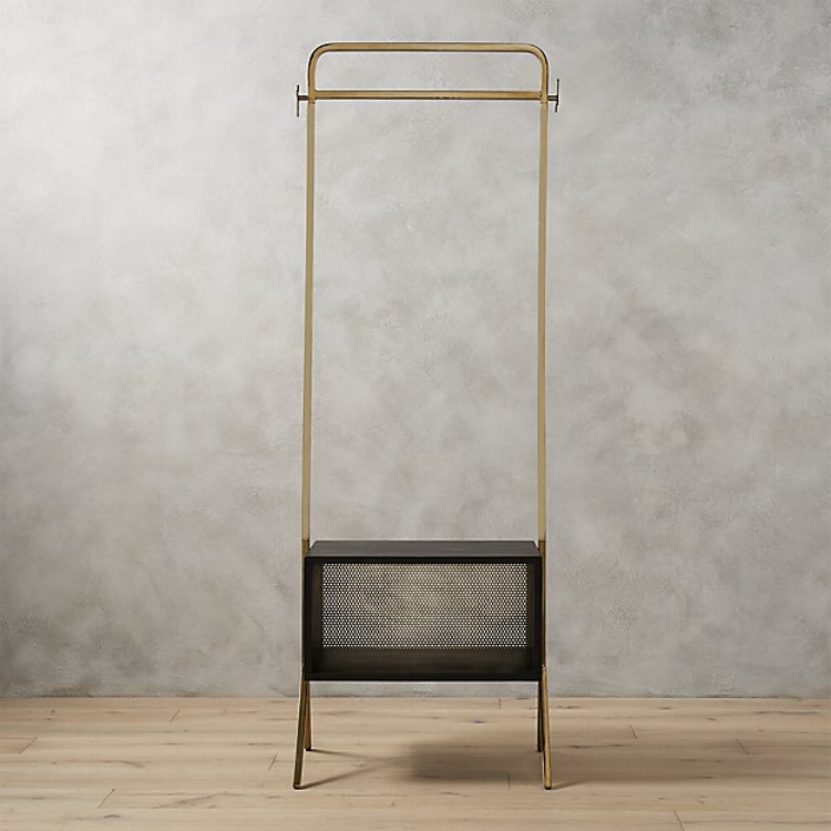 The  Valet Clothes Stand from CB2  is an affordable, sleek and beautiful solution for guest-storage in a home office.