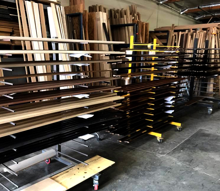 Photo of hand-stained mouldings and trim at Kenwood Floors Inc warehouse at City of Industry, California.