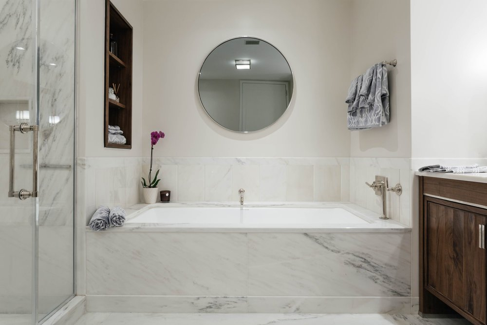 Modern marble bathtub and walk in standing shower