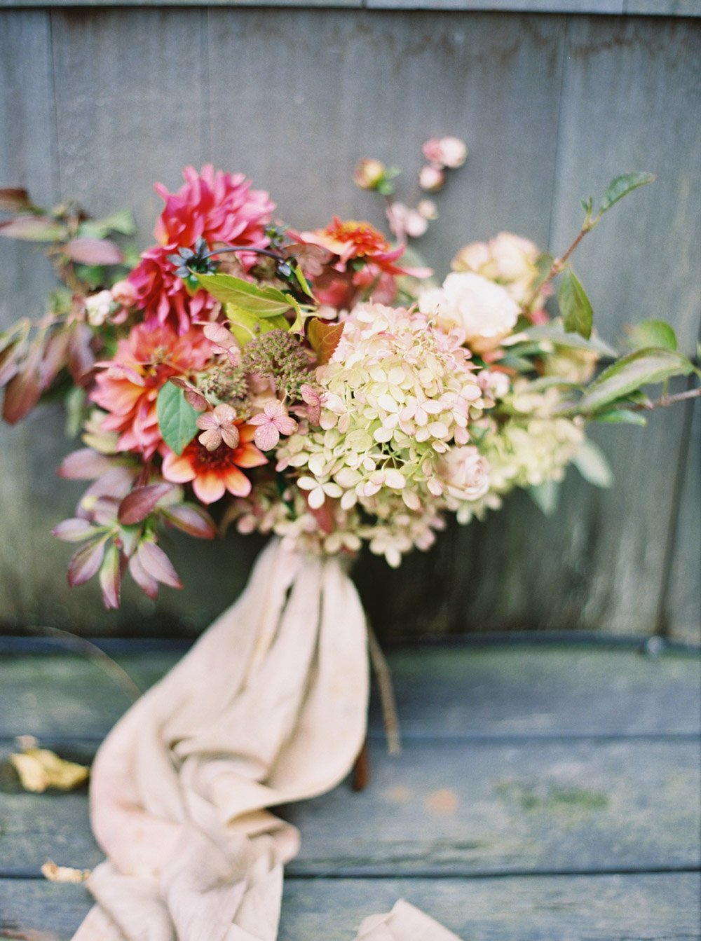 Bouquet of flowers resting on wooden background