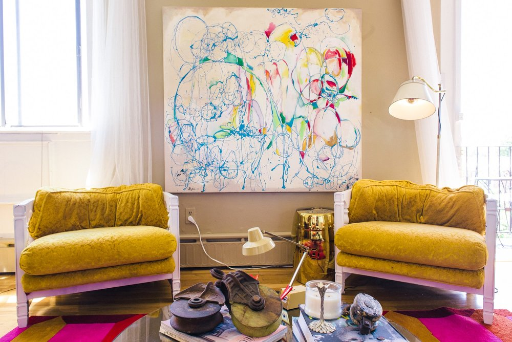 Sitting room area with abstract art on wall