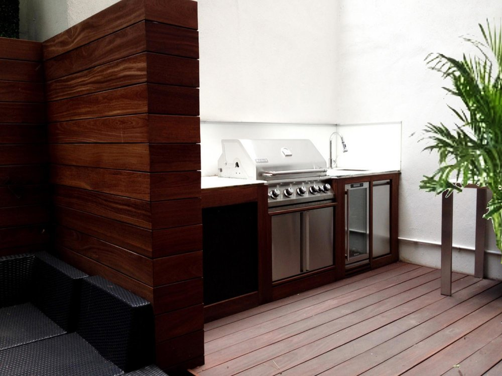 Outdoor cooking space with steel oven and sink