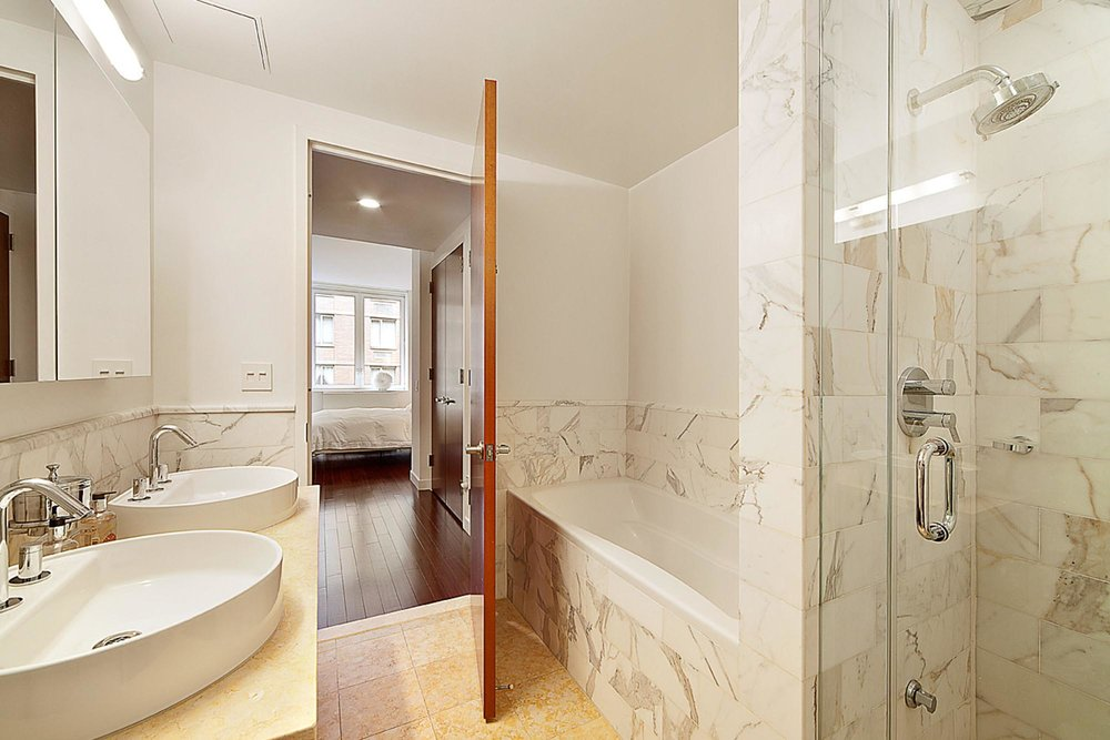 Bathroom with his and her sinks and walk in shower