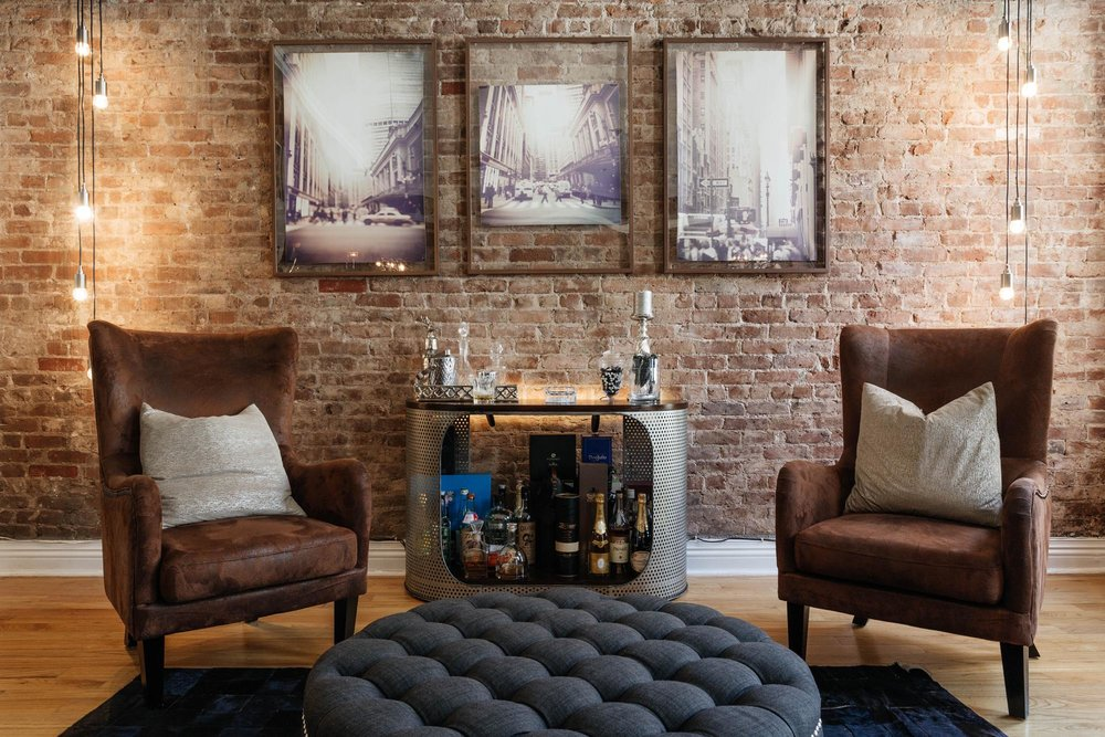 Sitting area with small bar and round ottoman
