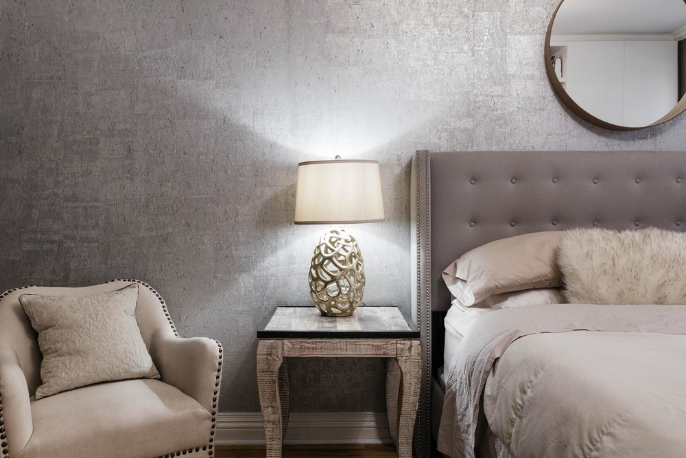 Bedside table with decorative lamp