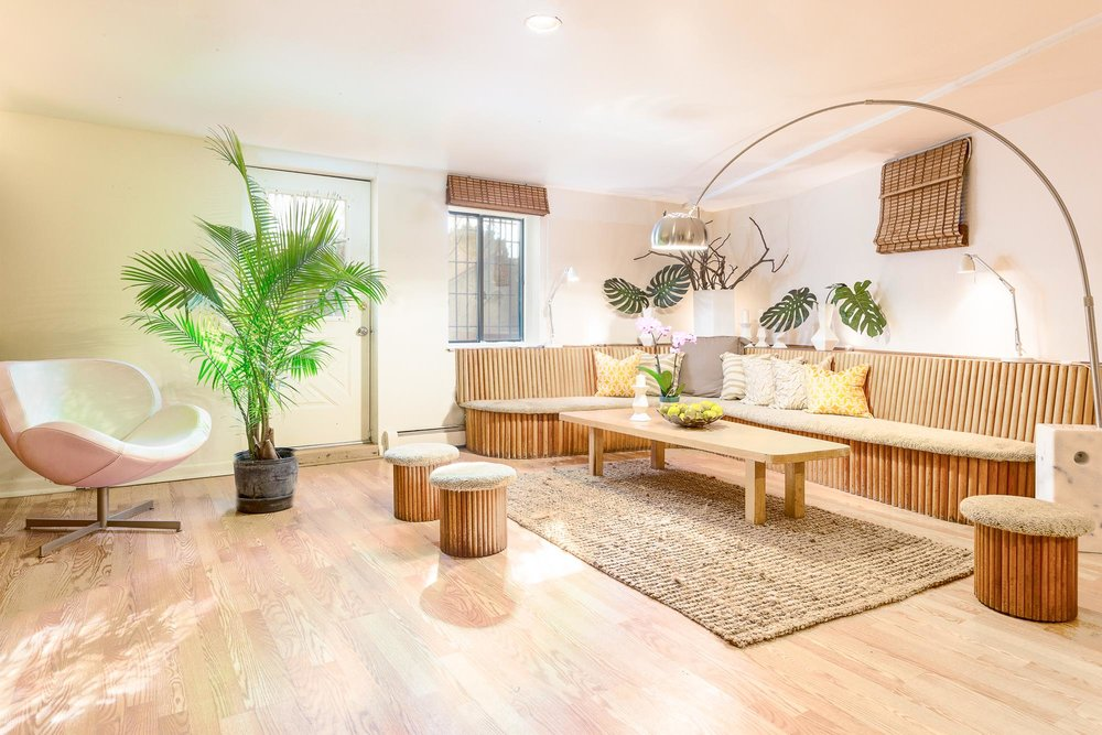 Long wooden sectional bench and large modern lamp