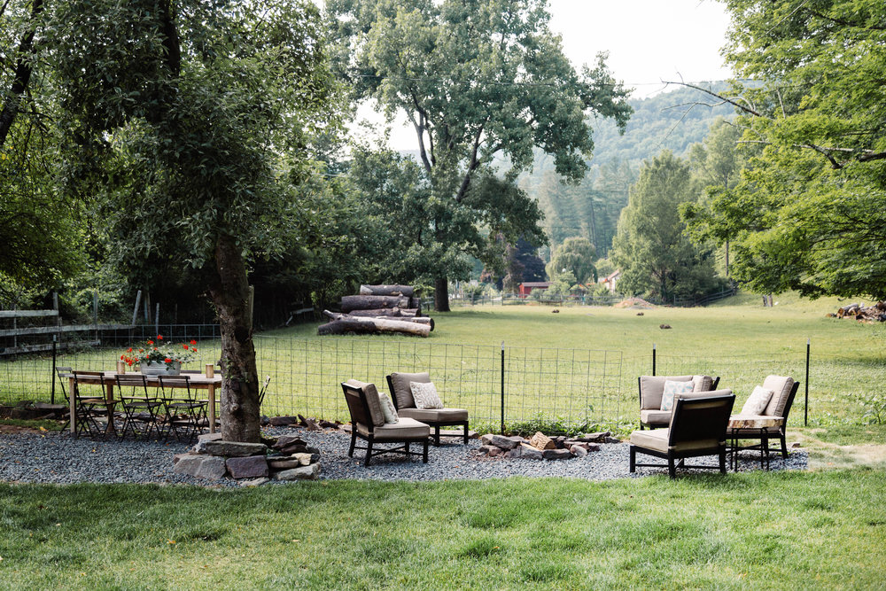 Outdoor seating area around bonfire setting