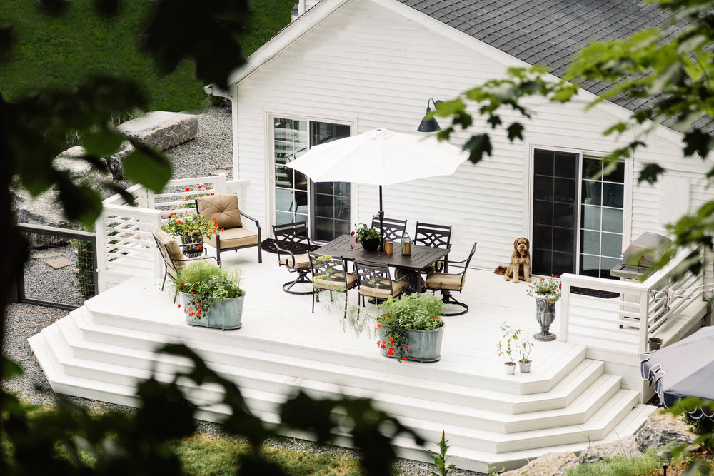 Broad patio area with seating and potted plants