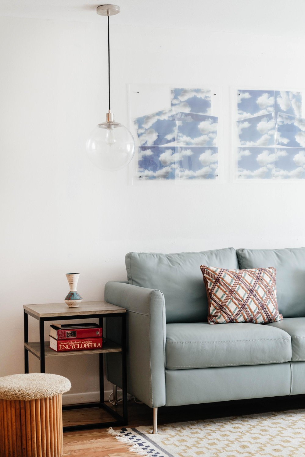 Corner of office area with pale blue sofa
