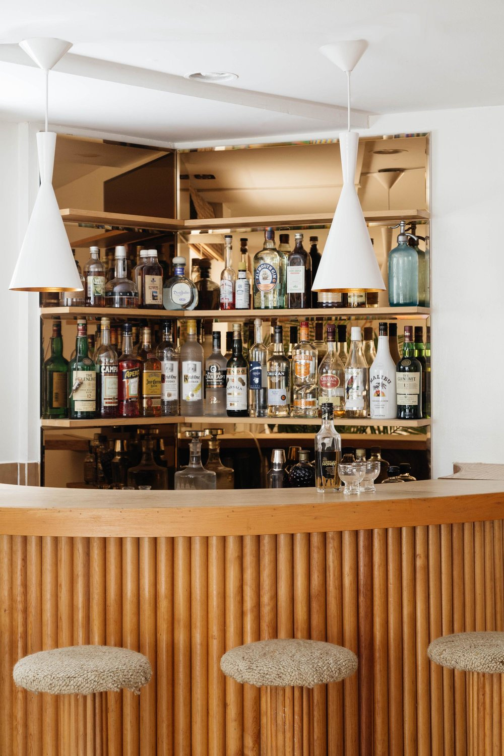 Custom wooden bar with high stools