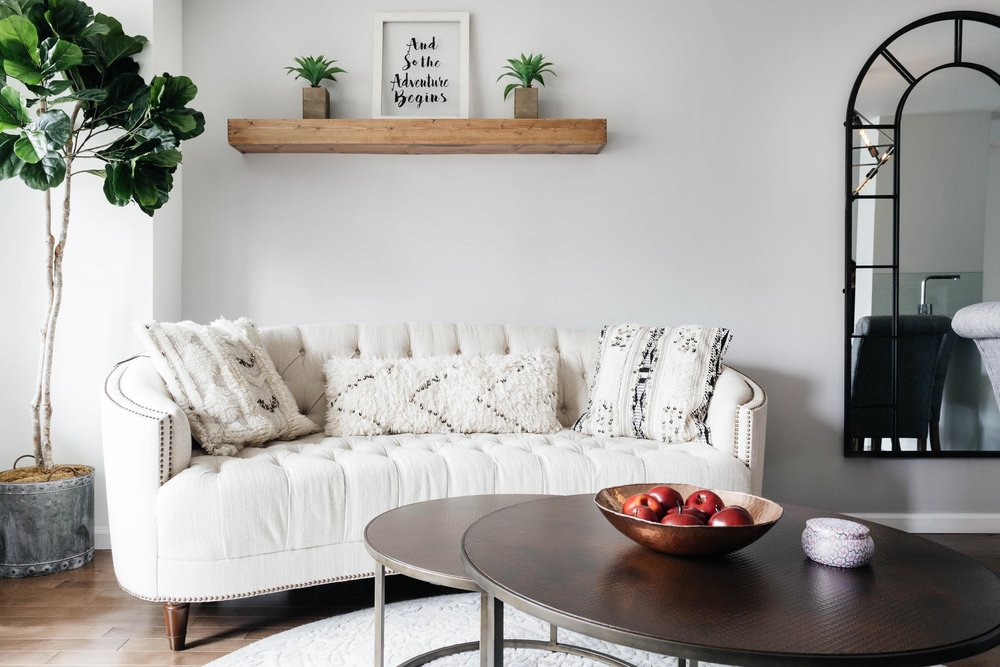 Living room space with white sofa and wooden table