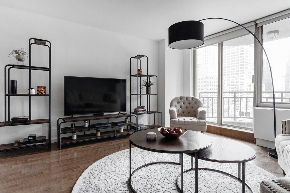 Living room area with black TV on stand