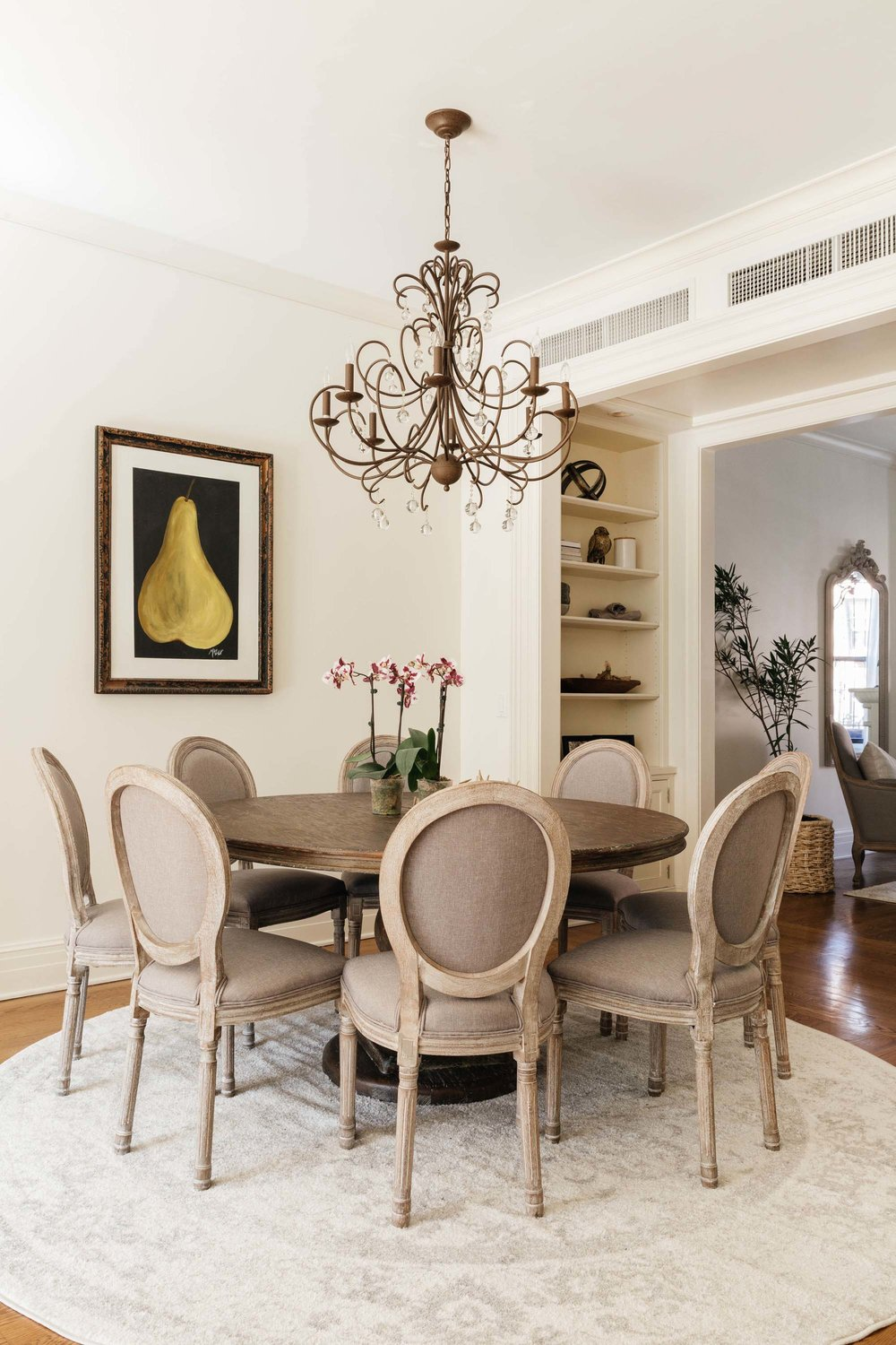 Round breakfast table with chandelier hanging overhead