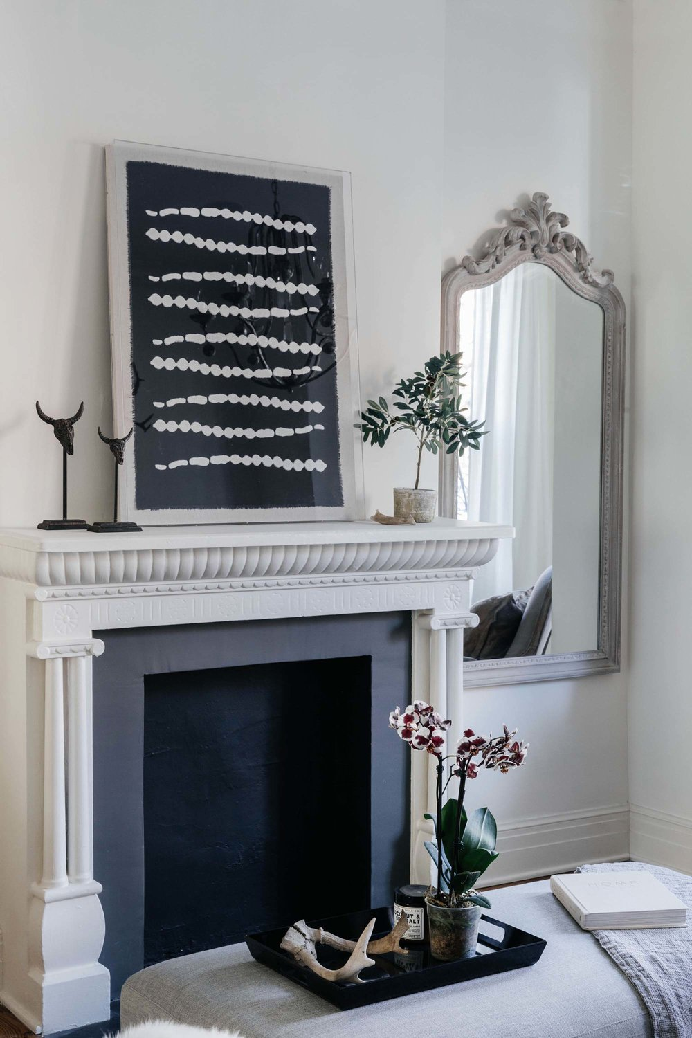 Fireplace with art resting above