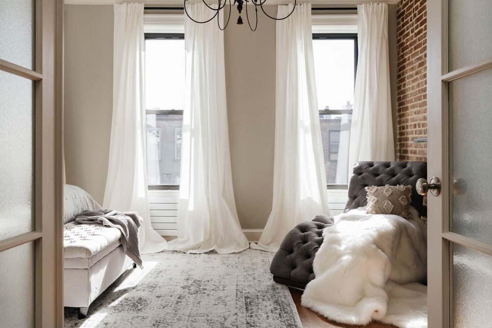 Bright bedroom with exploded brick wall