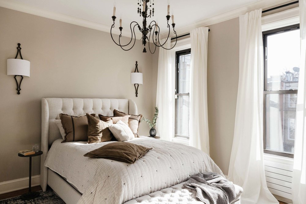 Bright bedroom with cream and white furnishings