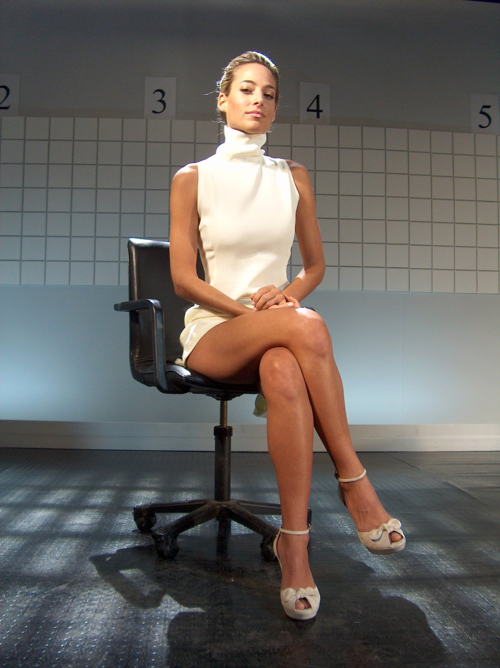 "Jessica as Sharon Stone in a parody of ""Basic Instinct"" for her network sketch comedy show ""Sputnik"""